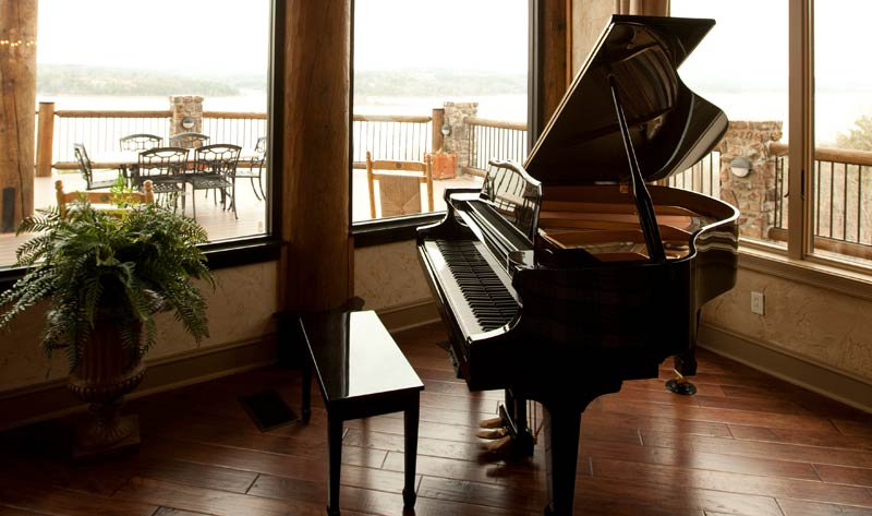 baby grand piano in outhouse