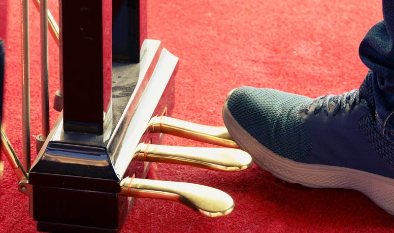 foot pressing on the piano pedals
