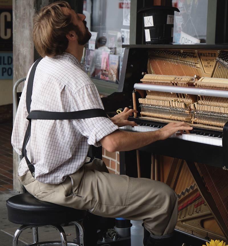 man playing a classic walter urpight piano