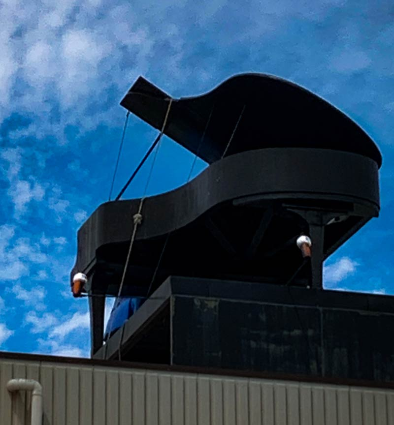 piano moved out side on top of a building roof