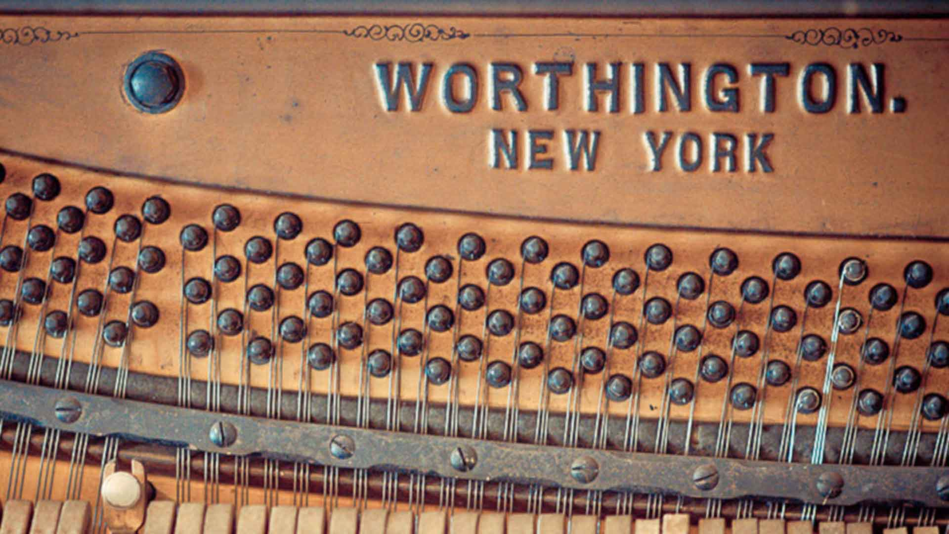 tuning pins and strings of a upright worthington new york piano background