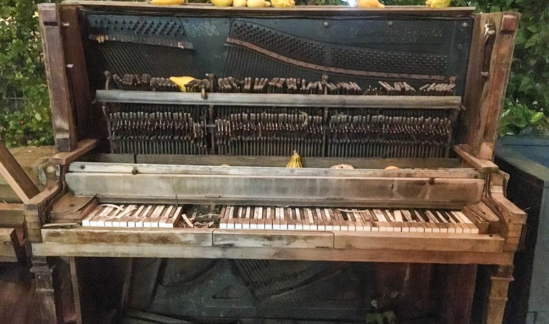 upright piano in dire condition